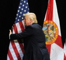 Trump hugging flag detail